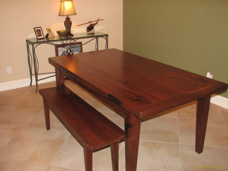 3. Reclaimed Walnut Table with Tapered Legs