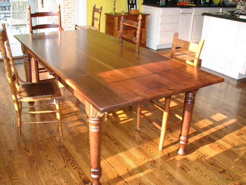 5. Reclaimed Walnut Table with Turned Legs