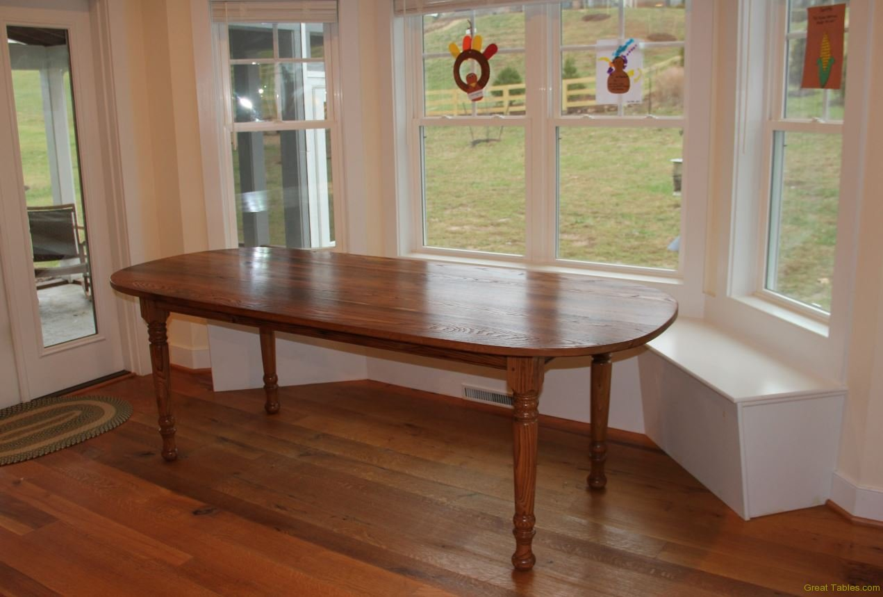 wormy chestnut Oval table