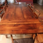 wormy chestnut Table with Traditional Extensions