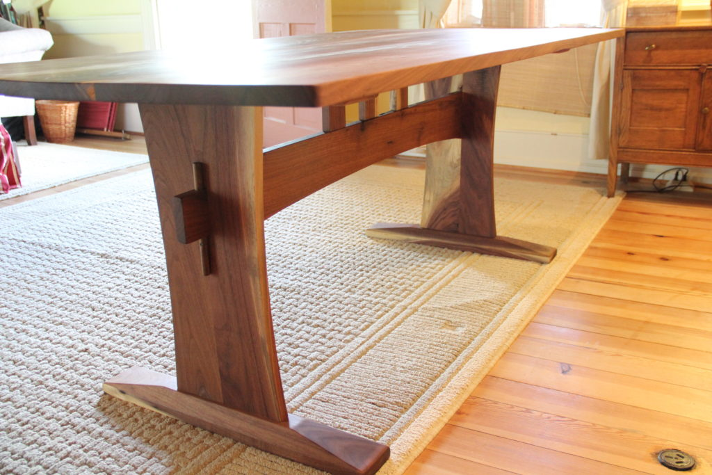 In inventory reclaimed walnut trestle dining table for Dining table overhang